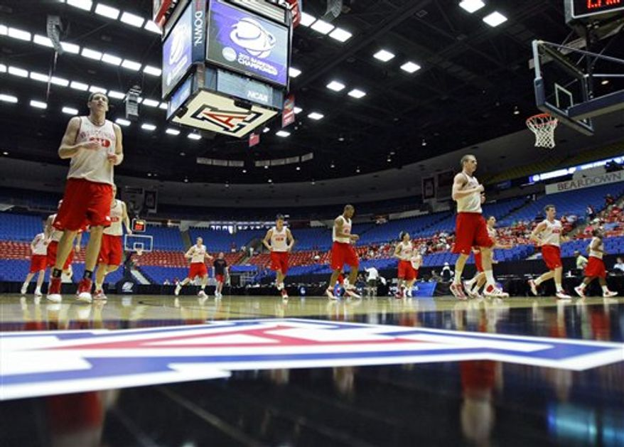 Wisconsin forward Keaton Nankivil shoots during a basketball practice Wednesday, March 16, 2011, in Tucson, Ariz., as Wisconsin is scheduled to face Belmont in a Southeast Regional NCAA college basketball tournament second-round game on Thursday. (AP Photo/Matt York)