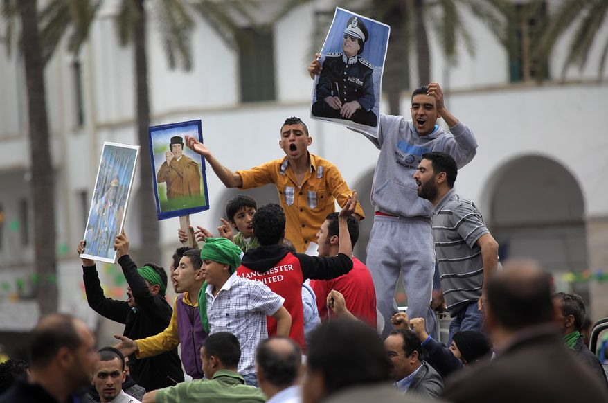 Supporters of Col. Moammar Gadhafi, the Libyan leader, celebrate on Green Square in Tripoli, Libya, on Tuesday, March 15, 2011, following an announcement on state television that Col. Gadhafi's forces had retaken the eastern city of Ajdabiya. (AP Photo/Jerome Delay)