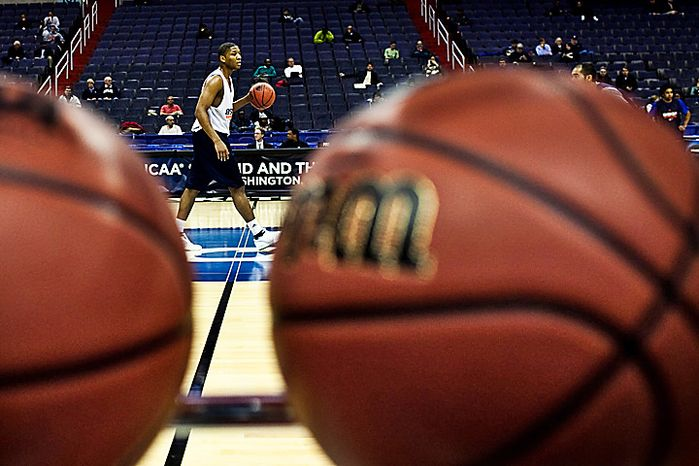 Bucknell University guard G.W. Boone dribbles down the court during practice at Verizon Center, in Washington. D.C. will be the host of the East Regional of the NCAA men's tournament in 2013, the NCAA announced Wednesday. (Drew Angerer/The Washington Times)