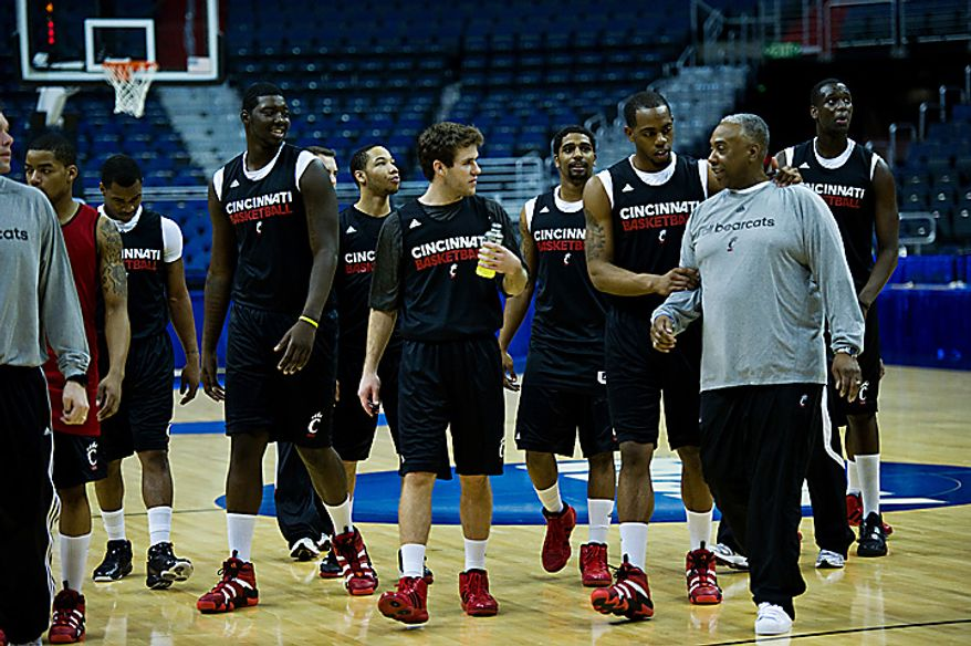 The University of Cincinnati basketball team leaves the court following their open practice at the Verizon Center, in Washington, D.C.,  Wednesday, March 16, 2011. (Drew Angerer/The Washington Times)