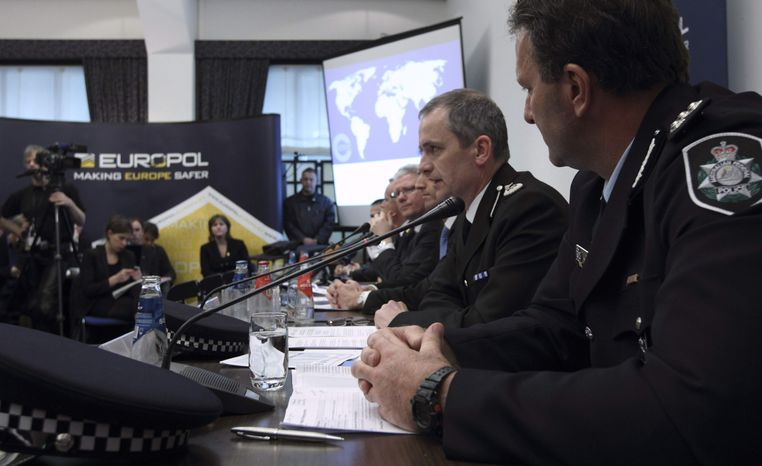 From left, Grant Edwards, Australian Federal Police, and Peter Davies, of the U.K. Child Exploitation and Online Protection Center, elaborate on the details of arrests linked to a global child abuse ring during a press conference in The Hague, Wednesday March 16, 2011. Police say they have arrested 184 suspects in a global investigation into a Dutch-based international pedophile ring involved in abusing dozens of children in more than 30 countries. (AP Photo/Peter Dejong)
