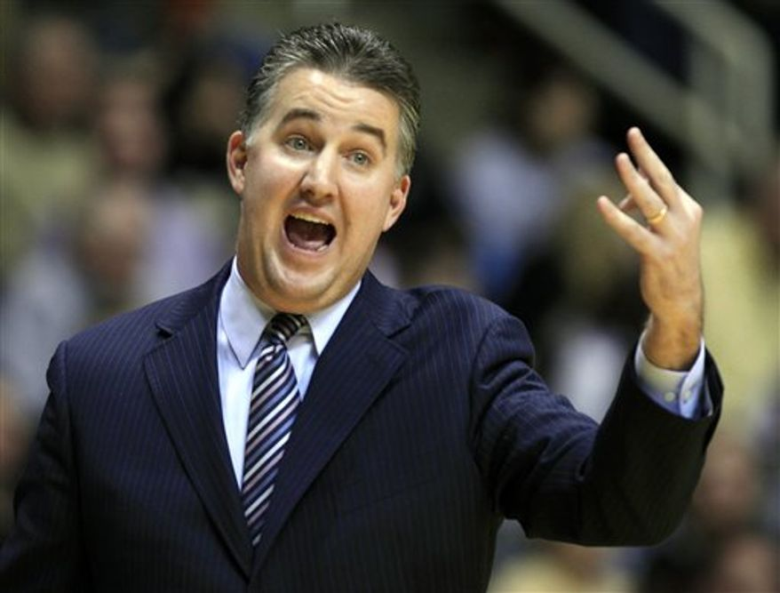 FILE - This March 19, 2011, file photo shows Purdue head coach Matt Painter speaking during a news conference at the Southwest NCAA college basketball tournament, in Chicago. Painter will meet with Missouri officials regarding their vacant head coaching position. However, Purdue said in a statement that it is committed to keeping him. (AP Photo/Charles Rex Arbogast, File)