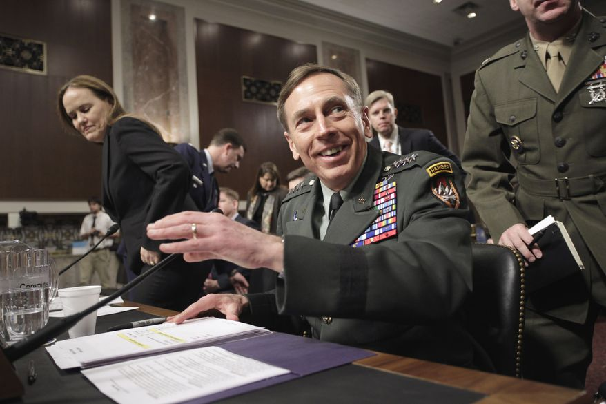 U.S. Army Gen. David H. Petraeus, commander of U.S. and NATO forces in Afghanistan, arrives on Capitol Hill in Washington on Tuesday, March 15, 2011, to testify before the Senate Armed Services Committee on the situation in Afghanistan. At left is Defense Under Secretary for Policy Michele Flournoy. (AP Photo)