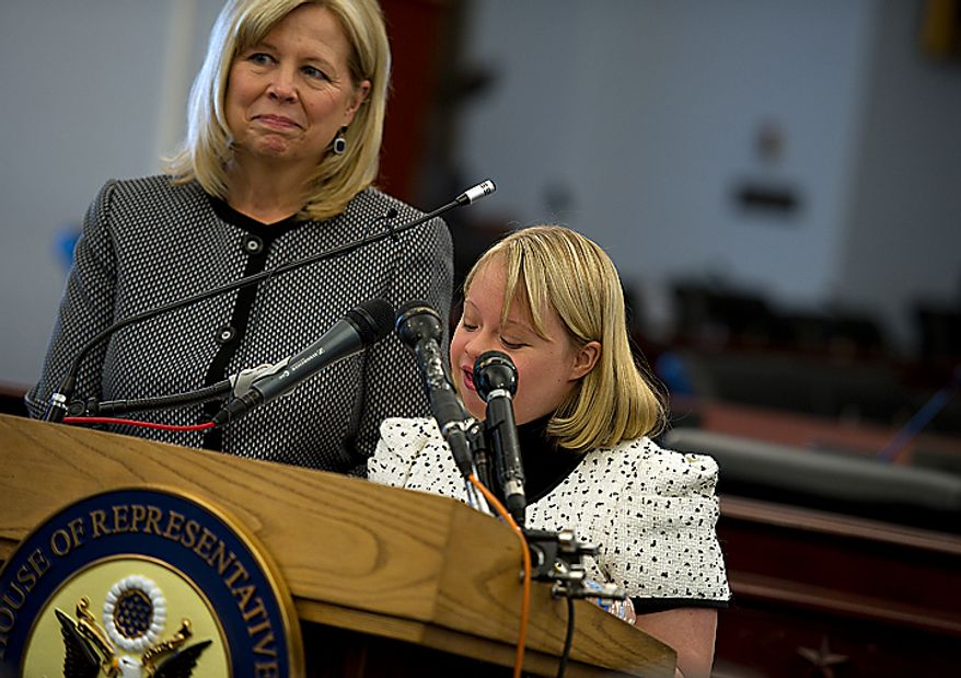 Lauren Potter, an actress on the show Glee, talks about her experiences being teased when she was younger because she has Down Syndrome during a Congressional briefing Wednesday, March 16, 2011 on the Bullying of Children with Special Needs while her mom Robin Sinkhorn looks on. (Barbara L. Salisbury/The Washington Times)