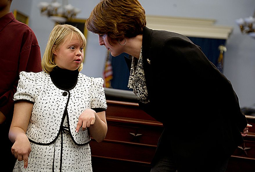 Lauren Potter, an actress on the show Glee, has a quiet conversation with Rep. Cathy Morris Rodger (R-Wash.) during a Congressional briefing on the Bullying of Children with Special Needs on Wednesday, March 16, 2011. Ms. Potter, who has Down Syndrome, spoke about her experiences being teased when she was little and about being a positive role model now. (Barbara L. Salisbury/The Washington Times)