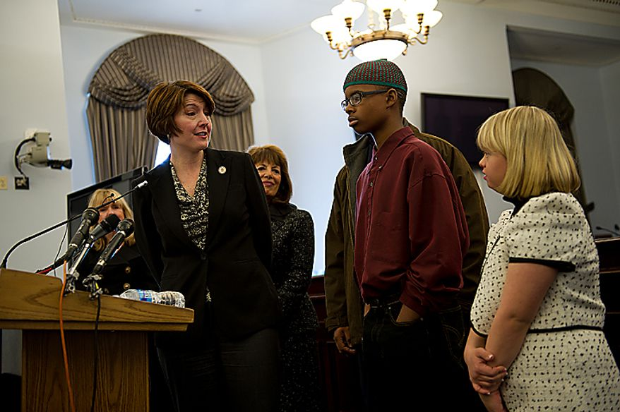 Congresswoman Cathy Morris Rodger (R-Wash.), left, thanks Isma'il Clayton, 13, who has Asperger's Syndrome, and Lauren Potter, an actress on the show Glee, who has Down Syndrome, for sharing their experiences and stories about being teased about being different during a Congressional briefing on the Bullying of Children with Special Needs on Wednesday, March 16, 2011. The congresswoman herself is the parent of a special needs child. (Barbara L. Salisbury/The Washington Times)