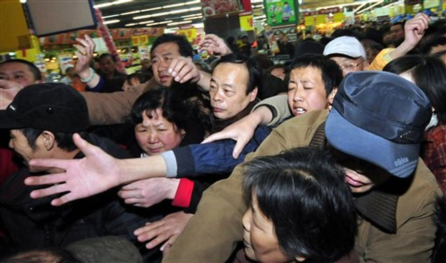 Shoppers mob a supermarket for salt purchase in Lanzhou in northwest China's Gansu province Thursday, March 17, 2011. Residents in a few Chinese cities have gone on a buying spree of iodized salt in the belief that it would ward off radiation pollution as a result of the troubled nuclear reactors in Japan following an earthquake. (AP Photo) CHINA OUT
