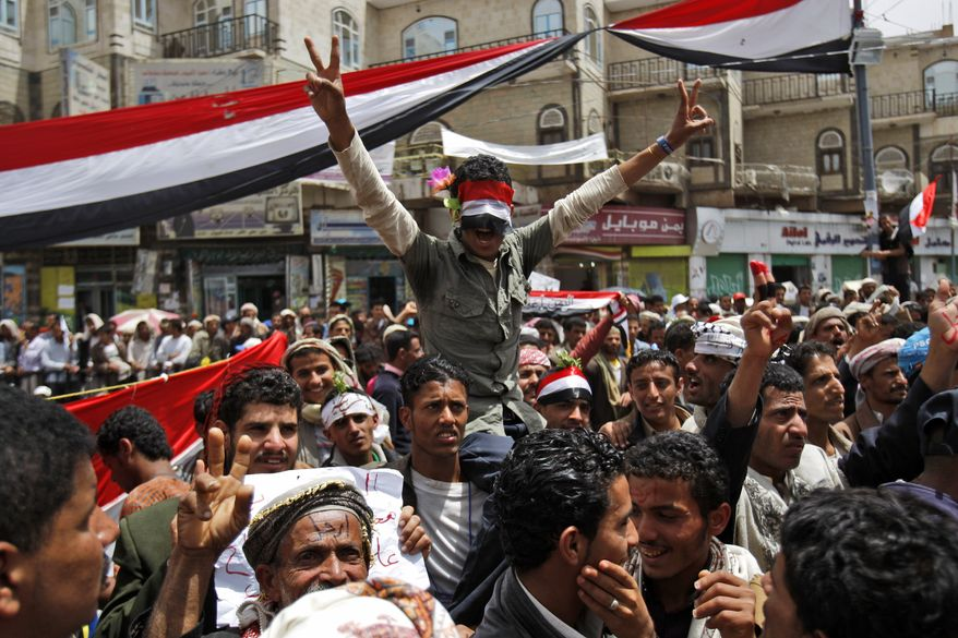 Anti-government protesters chant slogans during a demonstration demanding the resignation of Yemeni President Ali Abdullah Saleh in Sanaa, Yemen, the nation's capital, on Thursday, March 17, 2011. Witnesses said government supporters have attacked protesters camped out at a square in Sanaa. (AP Photo/Hani Mohammed)