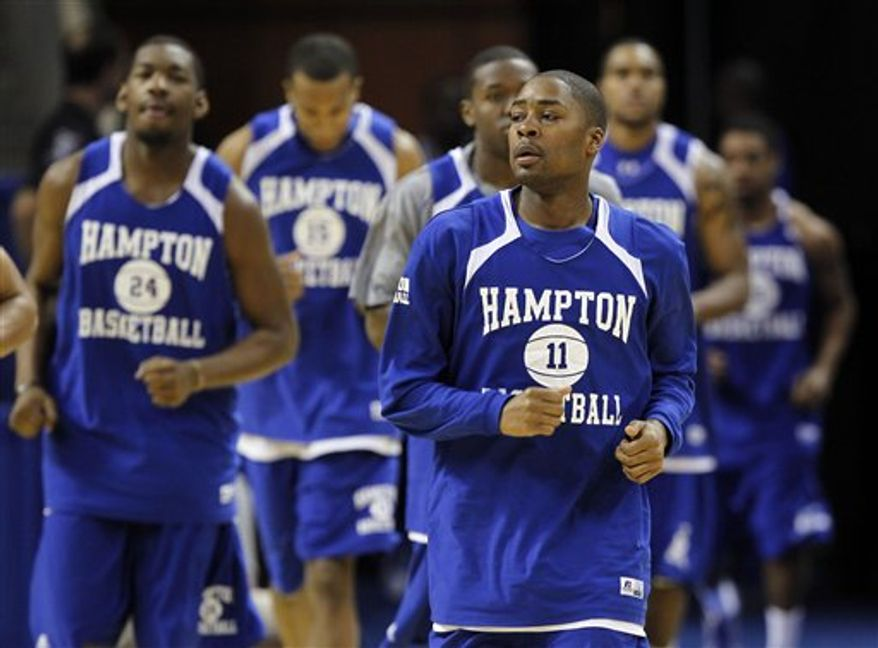 Hampton's Mike Tuitt (11) leads the team  to the floor before practice for an NCAA West regional tournament college basketball game in Charlotte, N.C., Thursday, March 17, 2011. Hampton plays Duke on Friday. (AP Photo/Bob Leverone)