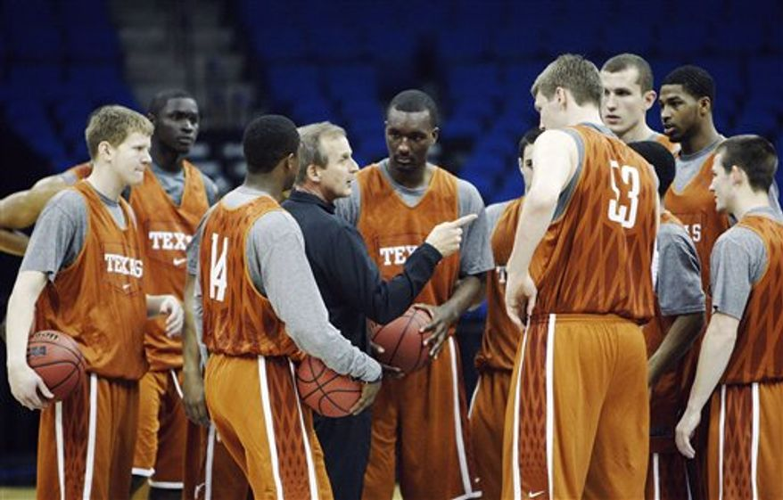 Texas guard Jordan Hamilton, right, laughs as he talks with head coach Rick Barnes, left, during a practice for the West Regional second round NCAA college basketball tournament in Tulsa, Okla., Thursday, March 17, 2011. (AP Photo)