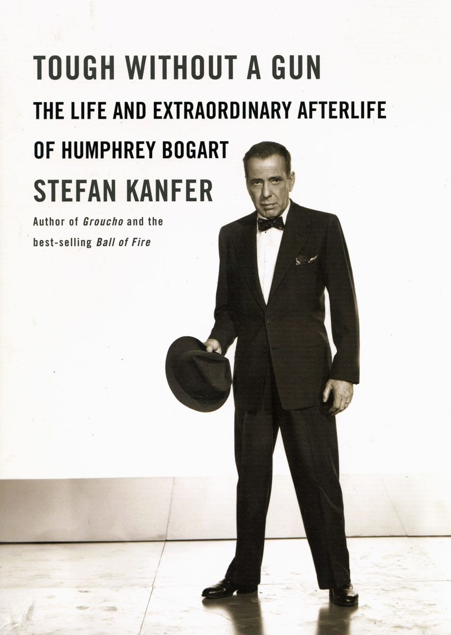 """The """"fanatical devotion"""" of his fans made actor Humphrey Bogart """"bigger in death than he had been in life,"""" biographer Stefan Kanfer writes."""