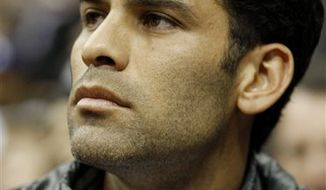 New York Red Bulls defender Rafael Marquez, of Mexico, watches an NBA basketball game between the New Jersey Nets and the Boston Celtics, Monday, March 14, 2011, in Newark, N.J. (AP Photo/Julio Cortez)