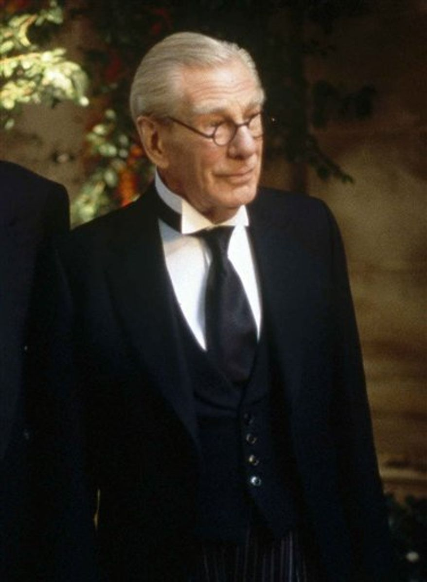 """FILE - In this 1997 photo originally released by Warner Bros. Pictures, Michael Gough portrays Alfred, the trusted butler of Bruce Wayne in a scene from the movie """"Batman and Robin.""""  Gough, the British actor who performed in more than 150 movies and television shows, including British science-fiction show """"Doctor Who,"""" died at home in England on Thursday, March 17, 2011.  He was 94. (AP Photo/Warner Bros. Pictures, Christine Loss)"""