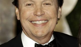 FILE - In this Feb. 27, 2011 file photo, Billy Crystal arrives at the Vanity Fair Oscar Party at the Sunset Tower in Los Angeles, Calif. (AP Photo/Carlo Allegri, file)