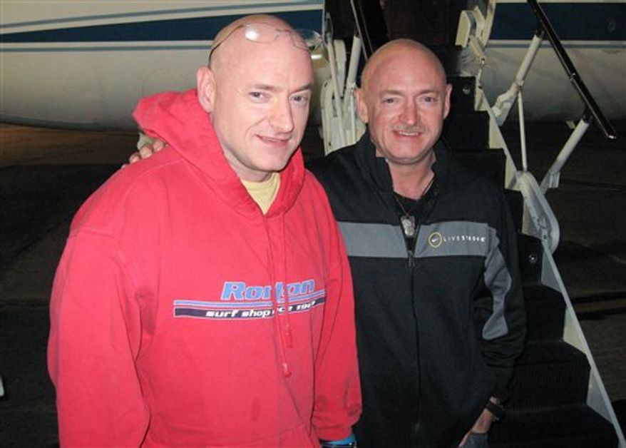 In this Thursday, March 17, 2010 picture, Expedition 26 Commander Scott Kelly, left, is reunited with his twin brother, Mark Kelly following a flight back to Ellington Field in Houston from Kustanai, Kazakhstan. Scott Kelly landed in Kazakhstan on March 16 with his Russian crewmates in the Soyuz TMA-01M spacecraft after 159 days in space, 157 days on the International Space Station. Mark Kelly is in the final weeks of training as Commander of the final flight of Endeavour, STS-134, that will spend more than a week docked to the ISS. Endeavour is targeted for launch on April 19, 2011. (AP Photo/NASA, Rob Navias)