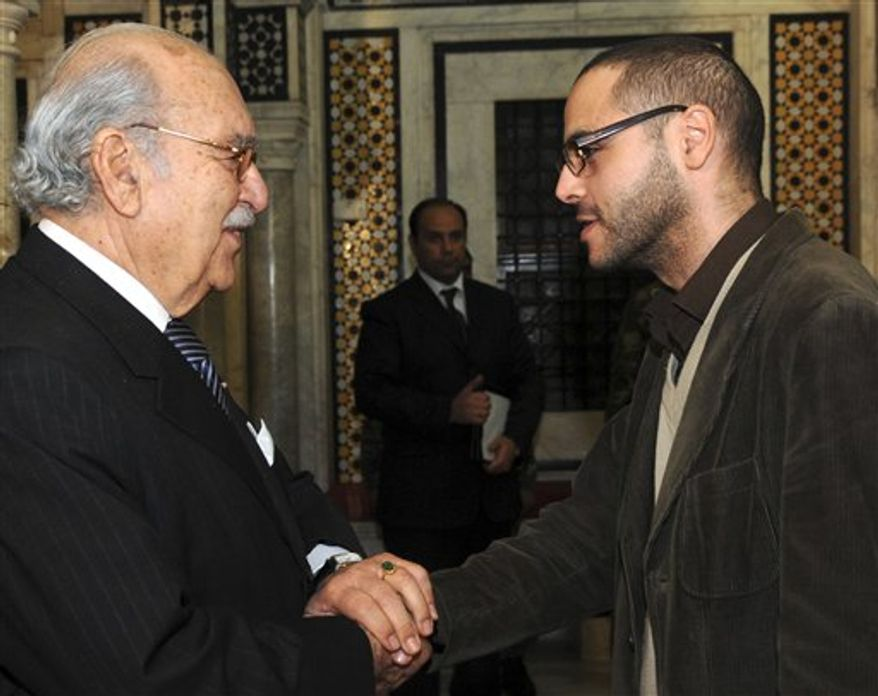 This Jan.18 2011 photo shows former blogger and now Tunisian deputy minister in charge of Youth and Sports, Slim Amamou, right, shaking hands with Tunisian interim President Fouad Mebazaa, in Tunis. At the height of the Tunisian uprising, Zine El Abidine Ben Ali's security agents repeatedly shut down websites and arrested, even tortured, some of the bloggers helping drive the protests against him. But two months after Ben Ali's fall, the caretaker government has embraced the very tools its predecessor tried to destroy. It has lifted web censorship. Key ministries now communicate with citizens through Facebook. (AP PHOTO/Hassene Dridi)