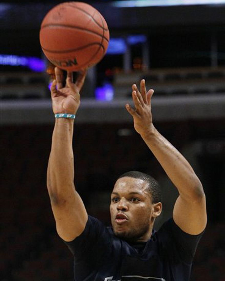 Georgetown's Chris Wright shoots the ball during practice for an NCAA Southwest Regional tournament basketball game in Chicago, Thursday, March 17, 2011. Georgetown will face Virginia Commonwealth in the second round Friday. (AP Photo/Charles Rex Arbogast)