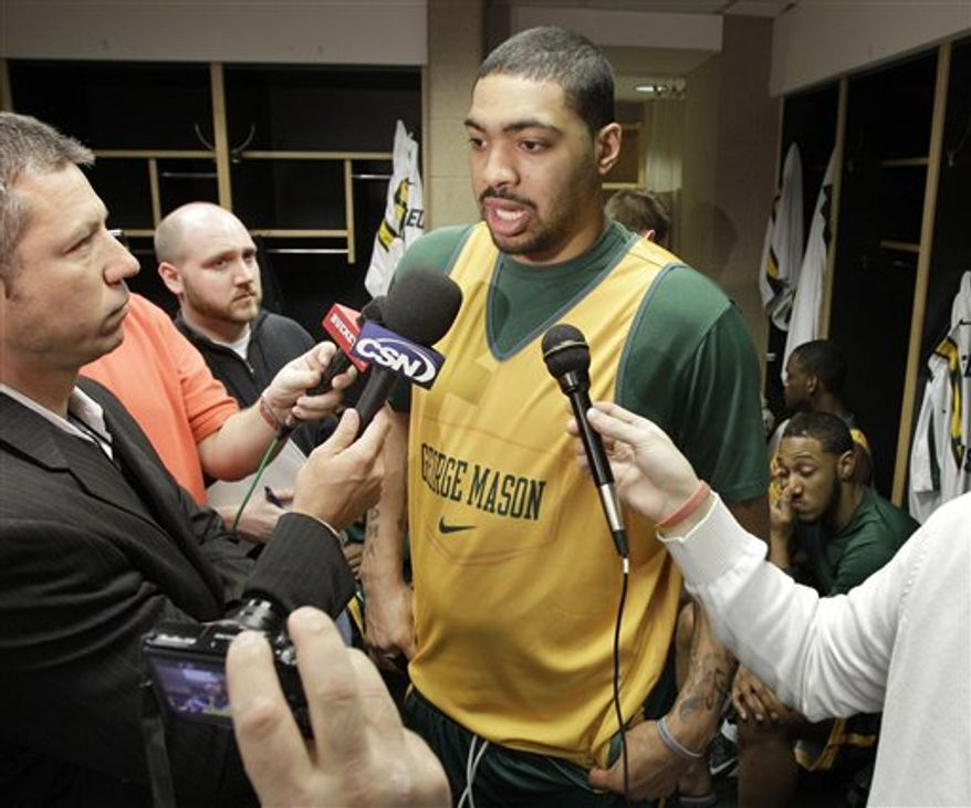 George Mason's Isaiah Tate, left, answers questions at a news conference with teammate Luke Hancock for a third-round East regional NCAA college basketball tournament game Saturday, March 19, 2011, in Cleveland. George Mason plays Ohio State Sunday. (AP Photo/Mark Duncan)