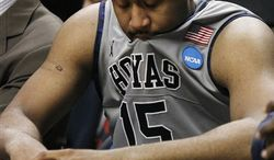 Georgetown's Nate Lubick, left, and Chris Wright sit dejected on the bench in the closing moments of Georgetown's 74-56 loss to Virginia Commonwealth in a second-round NCAA Southwest Regional tournament college basketball game in Chicago, Friday, March 18, 2011. (AP Photo/Charles Rex Arbogast)