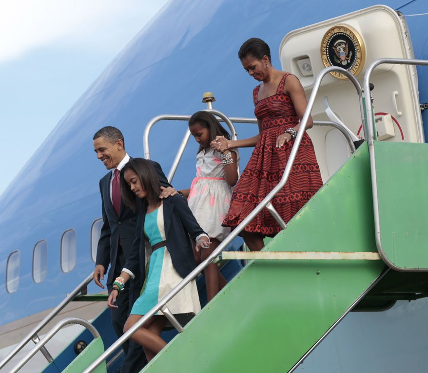 U.S. President Barack Obama, far left, with first lady Michelle Obama, far right, and daughters Malia, and Sasha, center, during their airport arrival at Brasilia Air Base in Brasilia, Brazil, Saturday, March 19, 2011. (AP Photo/Pablo Martinez Monsivais)