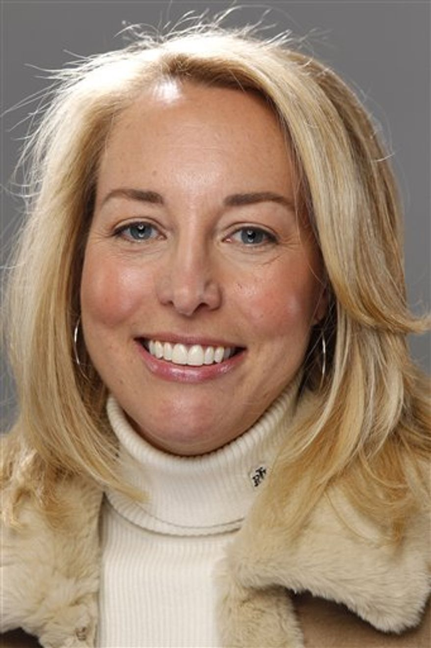 FILE - Valerie Plame Wilson of Count Down to Zero poses for a portrait at the Gibson Guitar Lounge during the Sundance Film Festival in Park City, Utah in this January 25, 2010 file photo. The New York Times reports Saturday March 19, 2011 that Wilson has a book deal with Penguin Group USA for a series of international suspense novels. The newspaper says she will team up with mystery writer Sarah Lovett on the books, which will feature a fictional operative.  (AP Photo/Carlo Allegri, File)