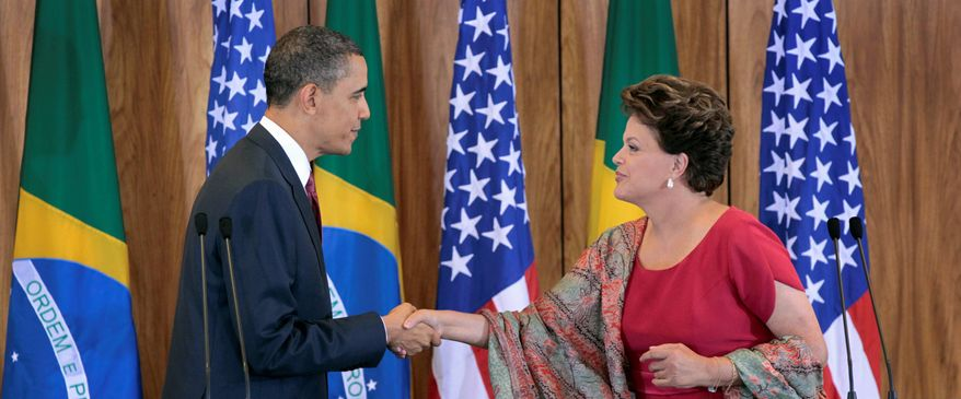 President Obama greets Brazilian President Dilma Rousseff after their joint news conference Saturday at the Palacio do Planalto in Brasilia, Brazil. Mr. Obama welcomed Brazil's rise as an economic power and said the U.S. will be an eager customer for oil exports. (Associated Press)