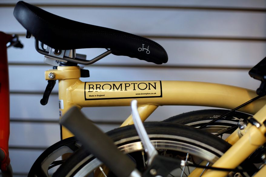 """Bromptons are built the way everything else used to be built,"" Mr. McGettigan said. ""It's light, it's fast. It has a quirky charm. It's tanklike but incredibly high-tech."" (Associated Press)"