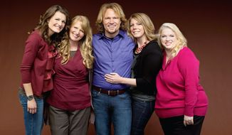 "** FILE ** Kody Brown hugs his wives, (from left) Robyn, Christine, Meri and Janelle. They appear on the reality series ""Sister Wives"" on TLC. ""'Sister Wives' shows that polygamy is rather boring,"" said Brian Barnard, a Utah-based religious-freedom lawyer. (Associated Press)"