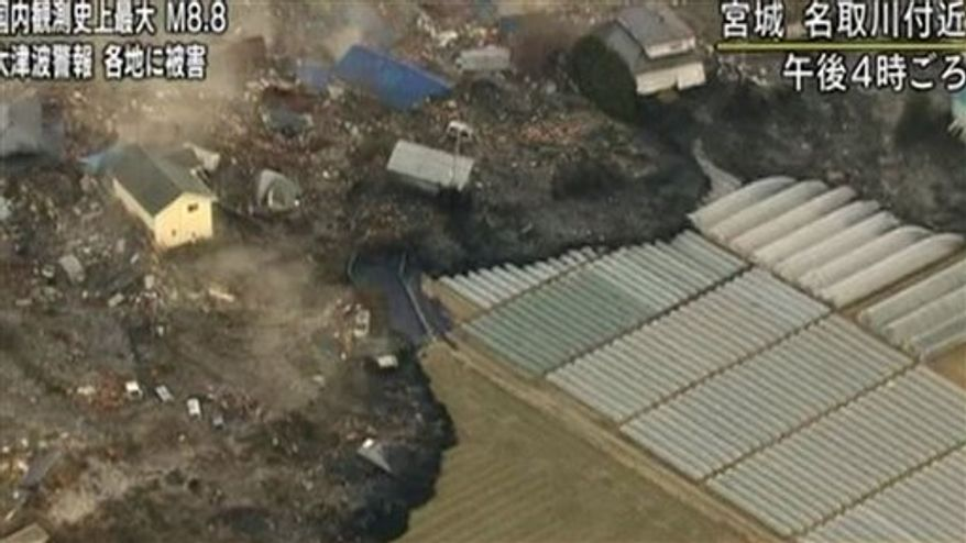 FILE - In this video image taken March 11, 2011 from Japan's NHK TV, a wave from the tsunami  heads to the coast in Miyagi Prefecture on the north east coast of Japan  following a massive earth quake.  (AP PHOTO/NHK TV) MANDATORY CREDIT, JAPAN OUT, TV OUT,  NO SALES, EDITORIAL USE ONLY