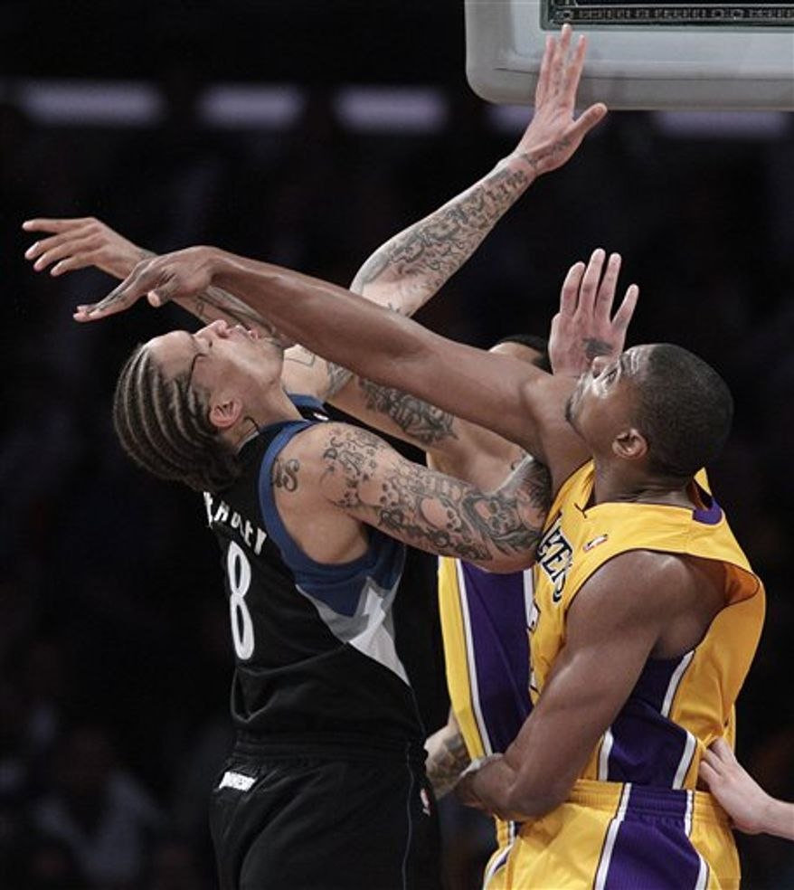 Los Angeles Lakers center Andrew Bynum, center, looks on after he was ejected from the game during the second half of an NBA basketball game with the Minnesota Timberwolves in Los Angeles, Friday, March 18, 2011. The Lakers won 106-98. (AP Photo)