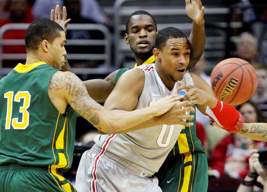 Ohio State's Jared Sullinger (0) loses the ball against George Mason's Isaiah Tate (13) and Mike Morrison in the NCAA third-round game Sunday. (Associated Press)