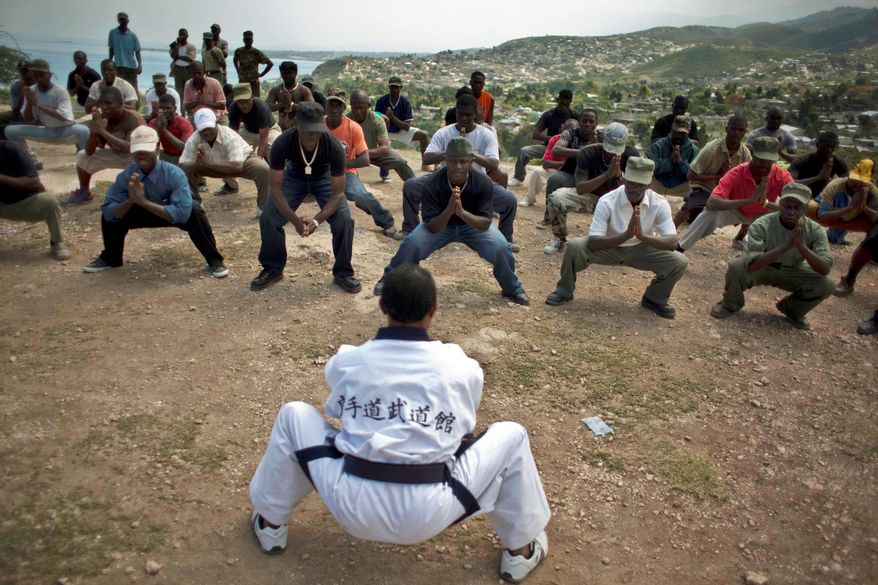 Civilian volunteers receive military instruction from veterans of Haiti's former army in Port-au-Prince. Haiti has been without an army since 1995, when President Jean-Bertrand Aristide disbanded the military after he was deposed in a coup and then restored to power with the help of U.N. forces. The two candidates who faced off in Sunday's presidential vote say they support restoring the armed forces in some form. (Associated Press)