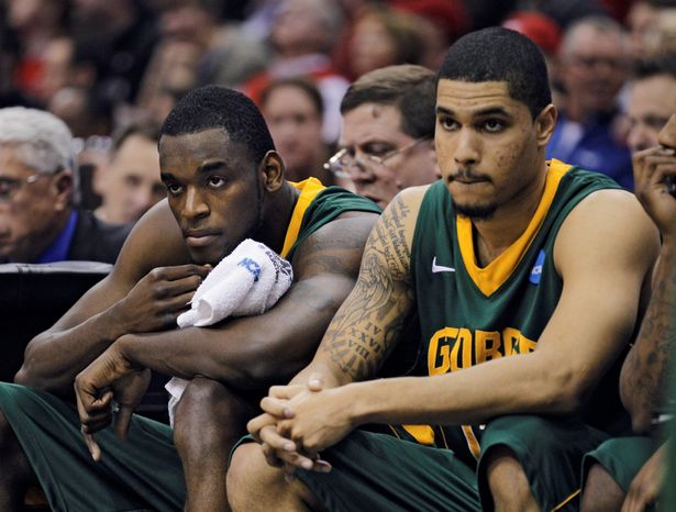George Mason's Mike Morrison (left) and Isaiah Tate watch the final moments of the team's 98-66 loss to Ohio State on Sunday. Although Tate is a senior, Morrison and Ryan Pearson will return in the Patriots' frontcourt next season. (Associated Press)