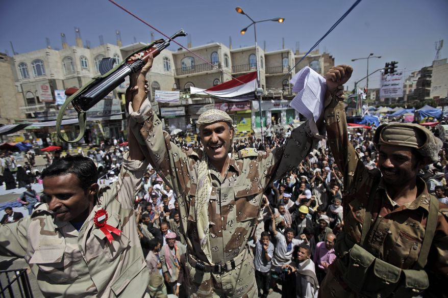 Three Yemeni army officers join anti-government protestors demanding the resignation of Yemeni President Ali Abdullah Saleh in Sanaa, Yemen, on Monday, March 21, 2011. (AP Photo/Muhammed Muheisen)