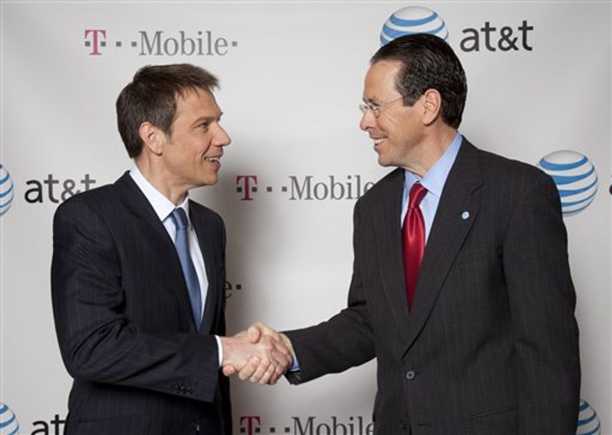 In this photo released by Newscast Monday, March 21, 2011, Deutsche Telekom Chairman and CEO Rene Obermann, left, and AT&T Chairman and CEO Randall Stephenson pose for photos in New York. AT&T Inc. said Sunday it will buy T-Mobile USA from Deutsche Telekom AG in a cash-and-stock deal valued at $39 billion that would make it the largest cellphone company in the U.S. (AP Photo/Newscast, Mark Dye) NO SALES