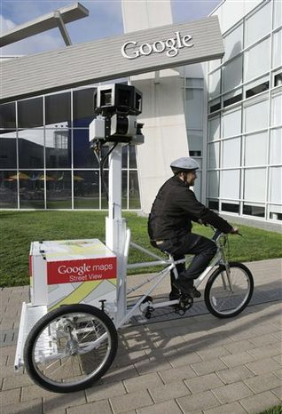 In this photo taken March 7, 2011, Matt Potter of Google pedals Goggle's new Street View Tricycle at Google headquarters in Mountain View, Calif. France's privacy watchdog has handed down its largest fine ever against Google Monday, March 21, 2011, for improperly gathering and storing potentially sensitive data from Wi-Fi networks for its Street View application. (AP Photo/Paul Sakuma)