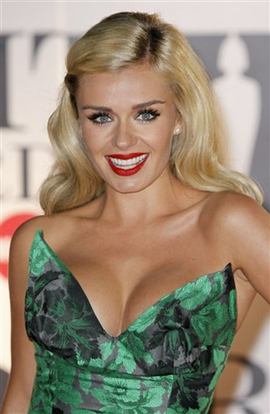 In this photo taken on Feb. 15, 2011, British singer Katherine Jenkins arrives for the Brit Awards 2011 at The O2 Arena in London. Jenkins said Monday, March 21, 2011 her eighth album will mark a return to her classical roots, after collaborating with famed pop producer David Foster on her previous release. (AP Photo/Joel Ryan)