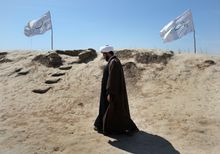 """An Iranian cleric tours a battlefield from the 1980-88 Iran-Iraq war on Sunday, the eve of the Persian New Year. President Obama's holiday message criticized Iran's """"campaign of intimidation and abuse."""" (Associated Press)"""