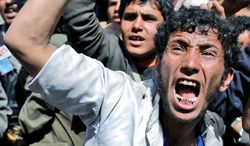 Protesters demand the resignation of Yemeni President Ali Abdullah Saleh in a demonstration Monday in the national capital, Sanaa. (Associated Press)