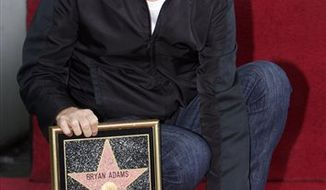 Canadian singer Bryan Adams is honored with a star on the Hollywood Walk of Fame in Los Angeles on Monday, March 21, 2011. (AP Photo/Damian Dovarganes)