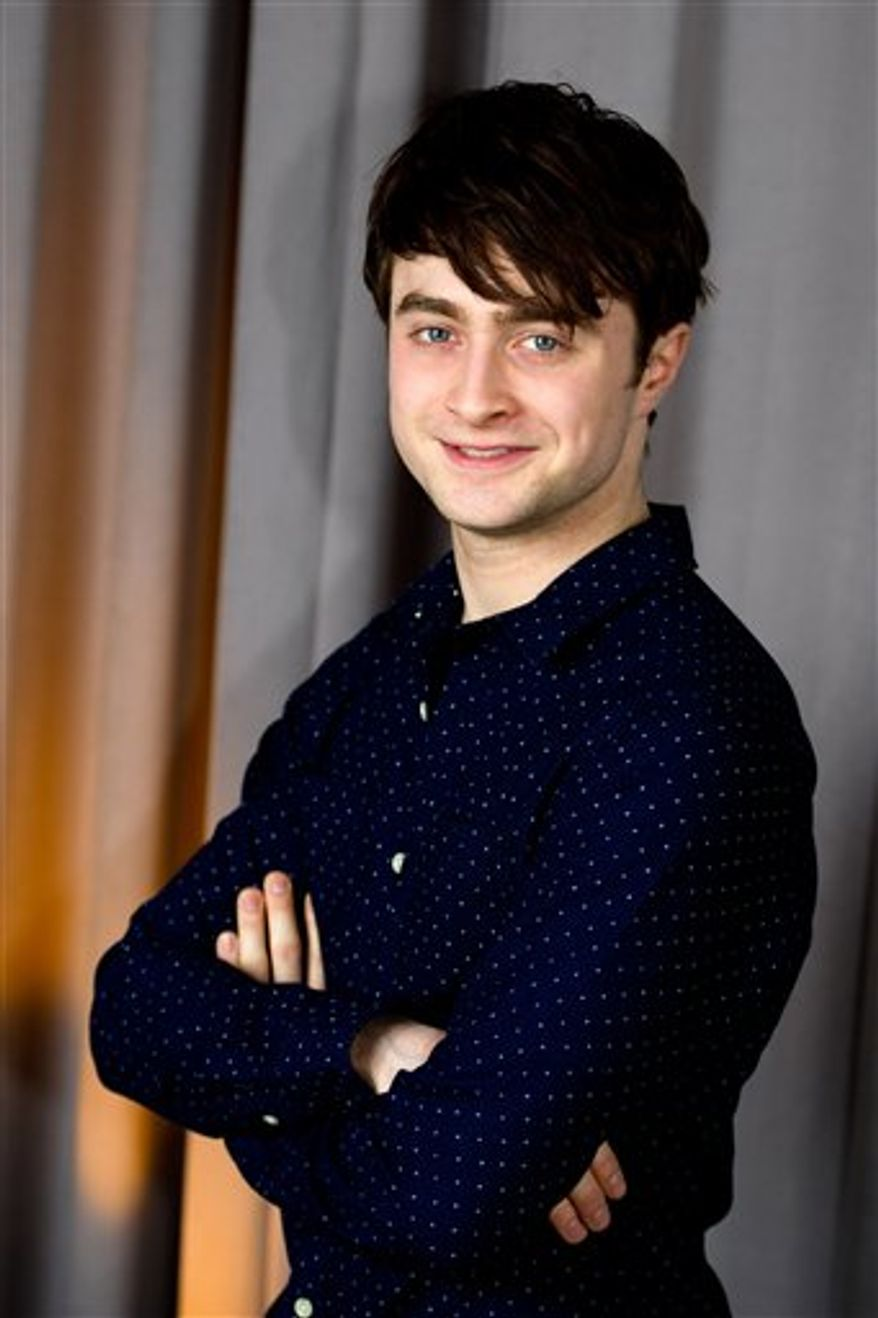 In this March 17, 2011 photo, actor Daniel Radcliffe poses for a portrait in New York. Radcliffe will be honored with the Trevor Project's Hero Award at a ceremony in New York in June, 2011.  (AP Photo/Charles Sykes)