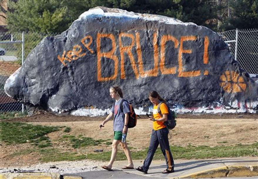A plea to keep Bruce Pearl as coach of the Tennessee men's basketball team is painted on a rock on school's campus Sunday, March 20, 2011, in Knoxville, Tenn. The NCAA has charged Pearl with unethical conduct and other recruiting violations after he revealed he lied during an investigation into recruiting. The rock is regularly painted with messages by students. (AP Photo/Mark Humphrey)