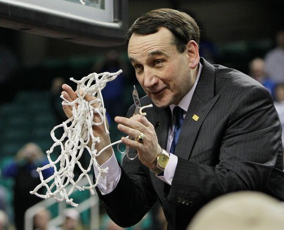 Duke coach Mike Krzyzewski applauds fans after Duke's 75-58 win over North Carolina on Sunday. He'll tie records held by Bob Knight and John Wooden with two more wins. (Associated Press)