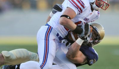 Navy linebacker Aaron McCauley, tackling SMU wide receiver Cole Beasle last year, decided to leave the Navy program, creating one of the holes at outside linebacker. (Associated Press)