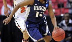Georgetown's Sugar Rodgers steals the ball from Maryland's Alyssa Thomas during the first half of a second-round game in the NCAA women's college basketball tournament Tuesday, March 22, 2011, in College Park, Md. (AP Photo/Gail Burton)