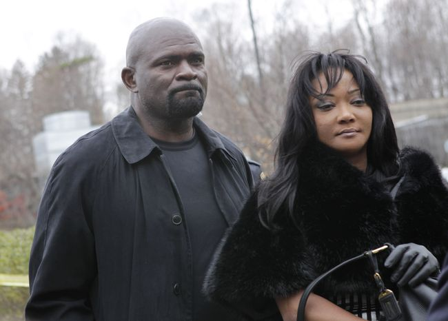 Former New York Giants football star Lawrence Taylor arrives with his wife, Lynette Taylor, for his sentencing at the Rockland County Courthouse in New City, N.Y., on Tuesday, March 22, 2011. The 52-year-old ex-linebacker pleaded guilty in January to sexual misconduct and patronizing a 16-year-old prostitute. (AP Photo/Seth Wenig)