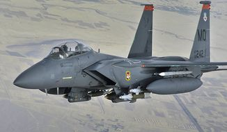 **FILE** A photo provided by the U.S. Air Force shows an F-15E Strike eagle in-flight over Afghanistan on Oct. 7, 2008. (Associated Press/U.S Air Force/Staff Sgt. Aaron Allmon)