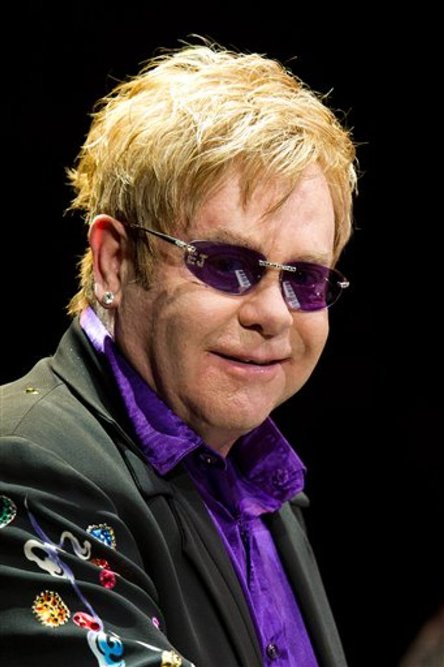 "FILE - In this March 16, 2011 file photo, Elton John performs in concert at Madison Square Garden in New York. NBC's ""Saturday Night Live"" has lined up Elton John and Helen Mirren for hosting duties on back-to-back shows in April. (AP Photo/Charles Sykes, file)"