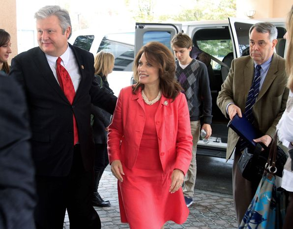 U.S. Rep. Michele Bachmann arrives with her husband, Marcus, at a state GOP fundraiser on March 12 in Nashua, N.H. Mrs. Bachmann recently has visited two other early nominating states. She is expected to announce by summer whether she will run for president in 2012. (Associated Press)