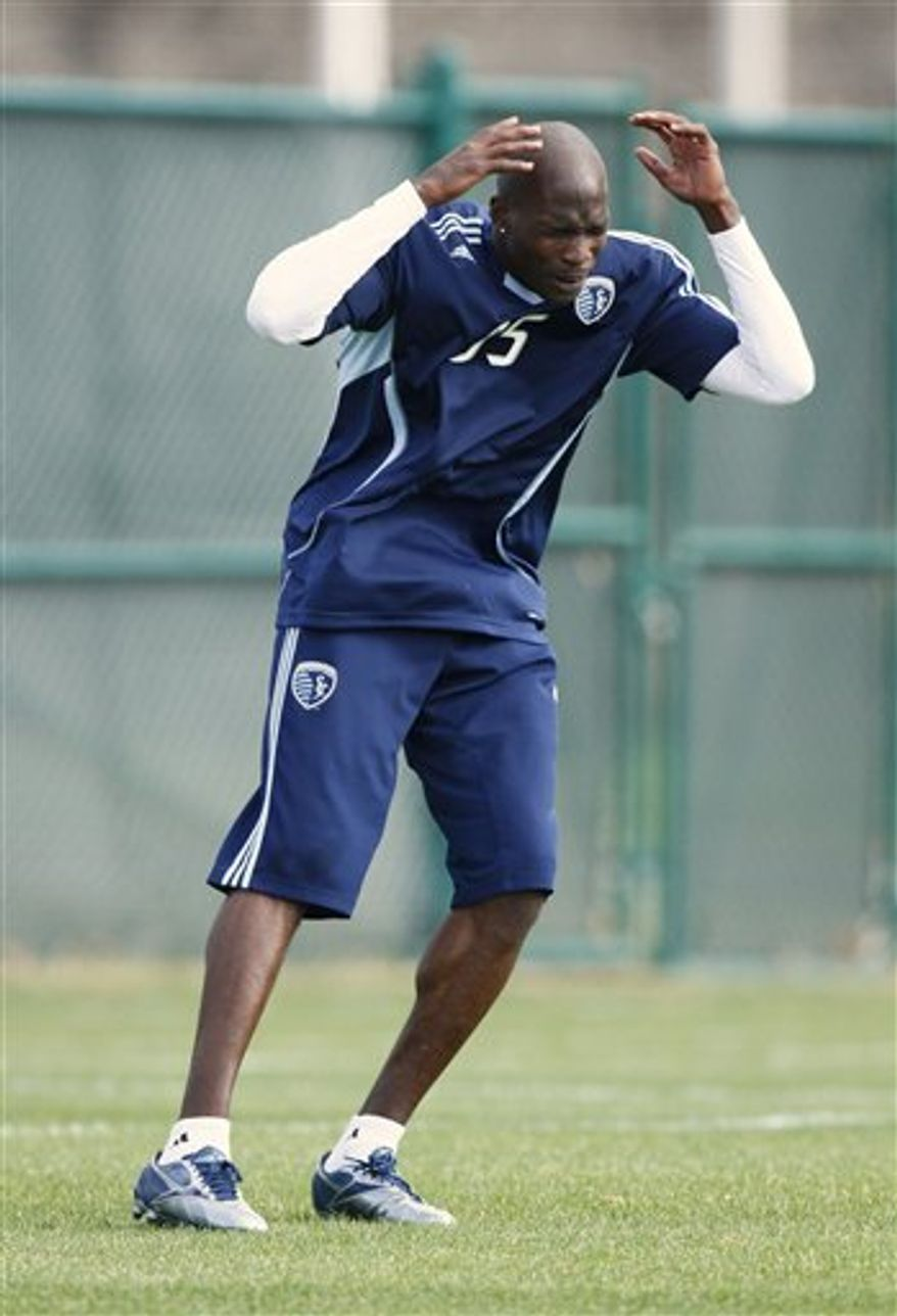 NFL star Chad Ochocinco reacts after missing a shot on goal during a four-day tryout with the Sporting Kansas City MLS soccer team, Wednesday, March 23, 2011, in Kansas City, Mo. With the NFL in a lockout, Ochocinco, a wide receiver for the Cincinnati Bengals, has said that it is a good time to check into another sport. (AP Photo/Ed Zurga)